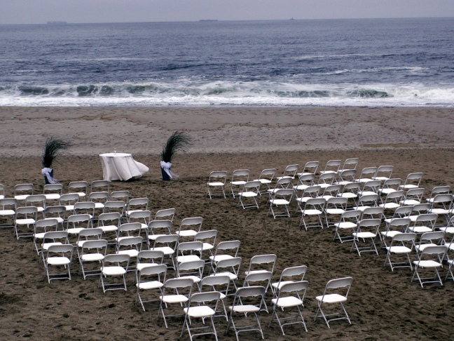 rainy wedding ceremony at seashore