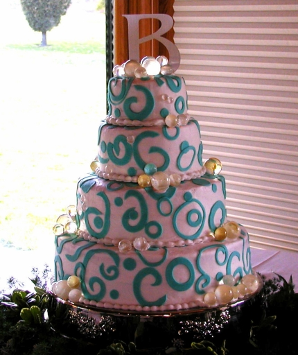 wedding cake with blue fondant swirls