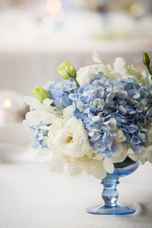 white and blue floral centerpiece